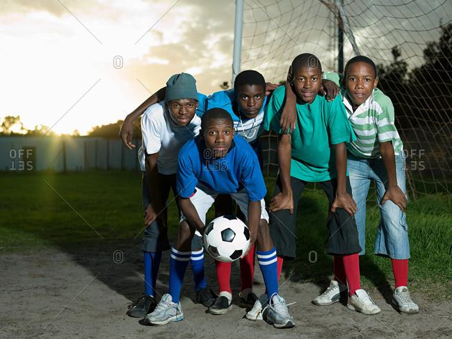 Teenage boys on football pitch
