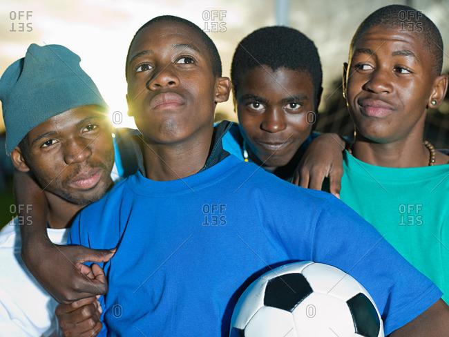 Teenage boys with football