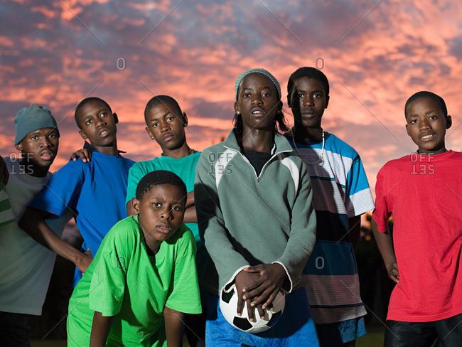 Group of teenage boys with football