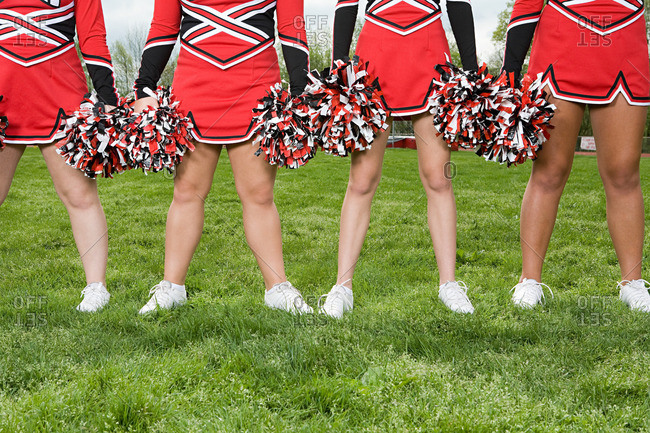 Cheerleaders with pom poms