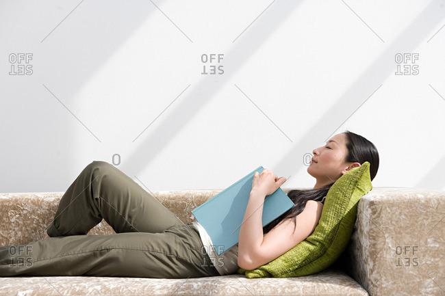 Japanese woman sleeping on sofa