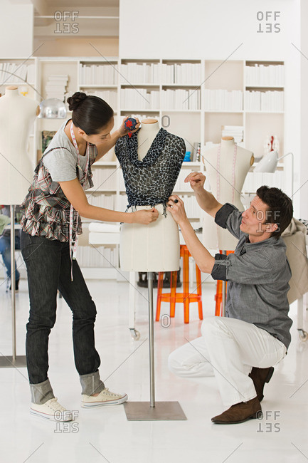Fashion designers with tailors dummy