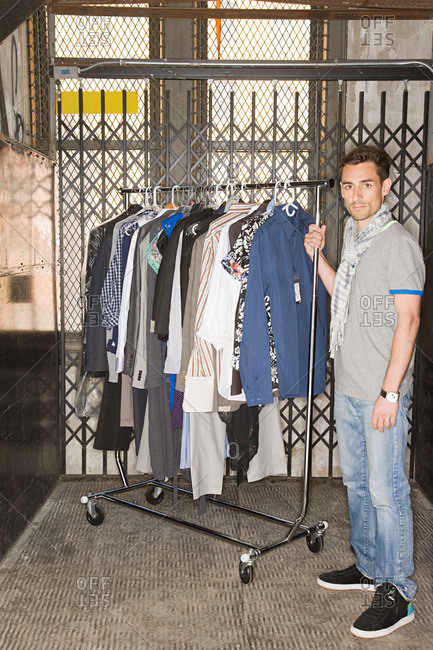 Man with rail of clothes