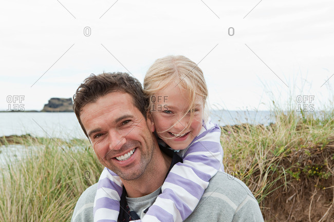 Father and daughter at the coast