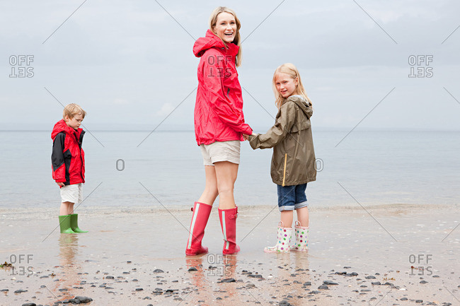 Mother and children by the sea