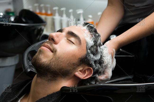Man having his hair shampooed