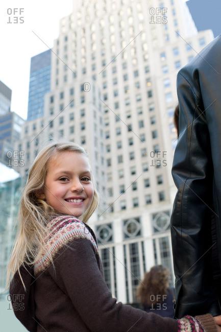 Girl by skyscraper