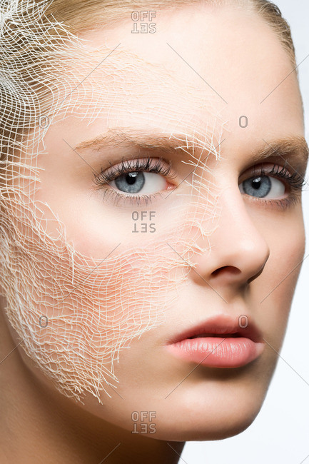 Woman with gauze on face