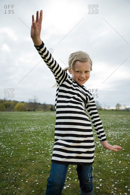 Girl with arm raised