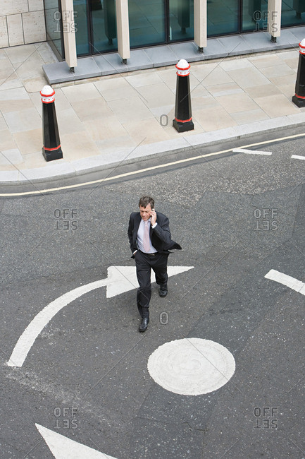Elevated view of a businessman crossing the street