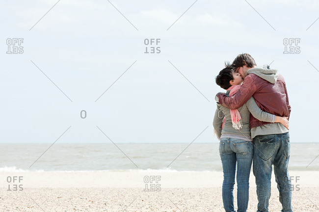 Young couple kissing by the sea