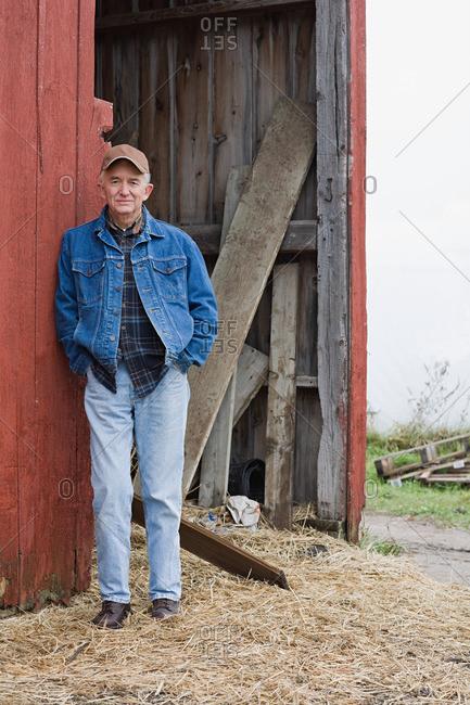 Farmer outside barn