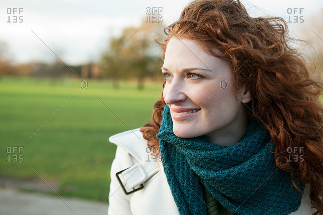 Portrait of a smiling red haired woman