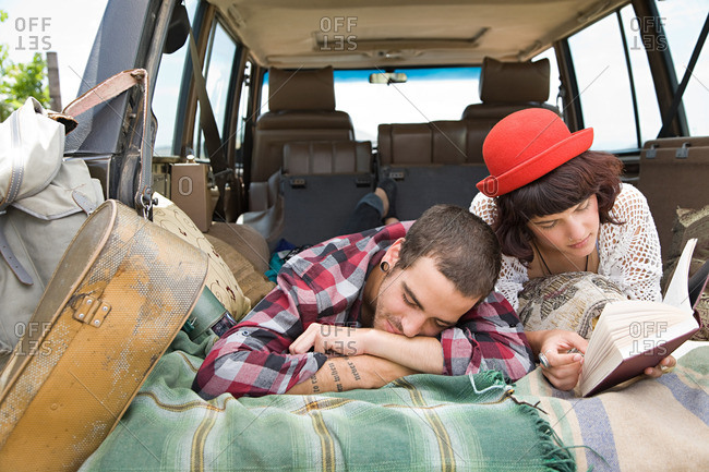 Couple lying in back of suv