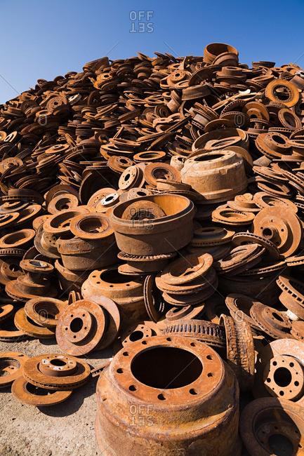 Stack of rusting metal - Offset