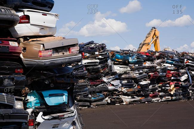 Cars in scrap yard - Offset