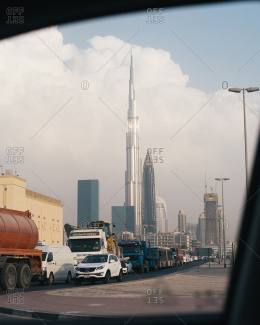 Dubai, United Arab Emirates  - October 14, 2015: Burj Khalifa skyscraper and city traffic
