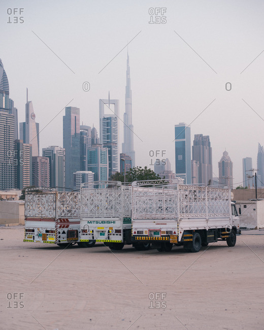 Dubai, United Arab Emirates  - October 14, 2015: Transport trucks parked near the skyline