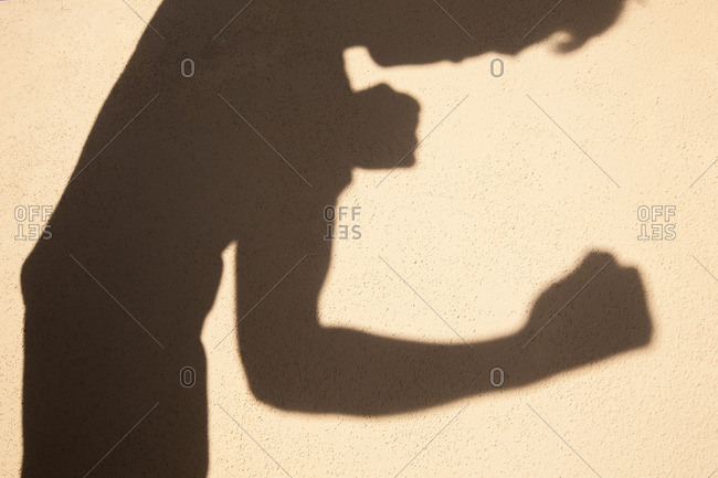 Shadow of a man in a fighting position