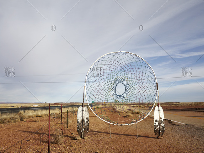 Oversized dream catcher on the side of a highway in the desert