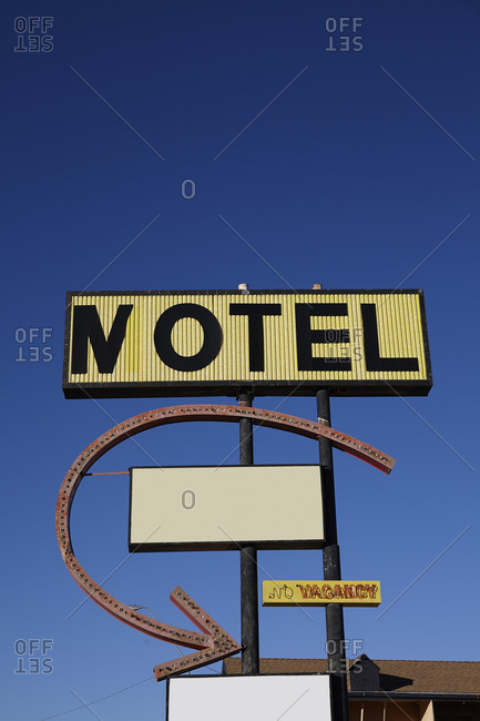 Old roadside motel sign and arrow