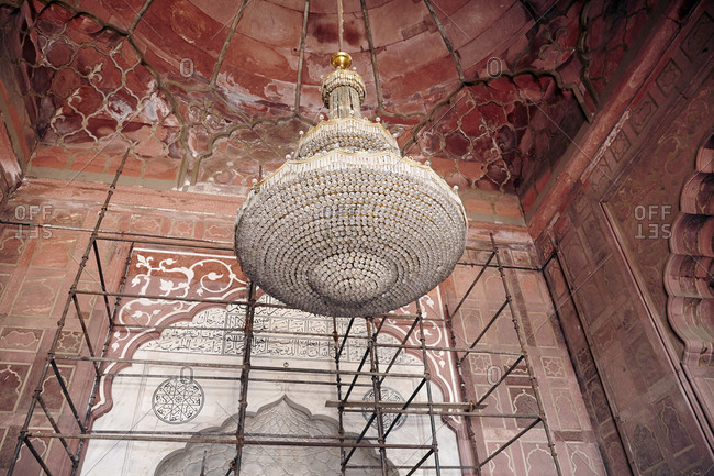 Chandelier and scaffolding at the Jama Masjid in Delhi