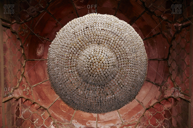 Chandelier and red sandstone ceiling of the Jama Masjid, Delhi