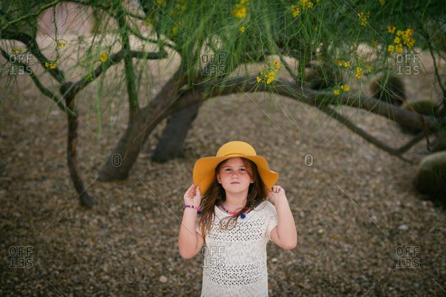 Young girl standing under tree in Zen garden