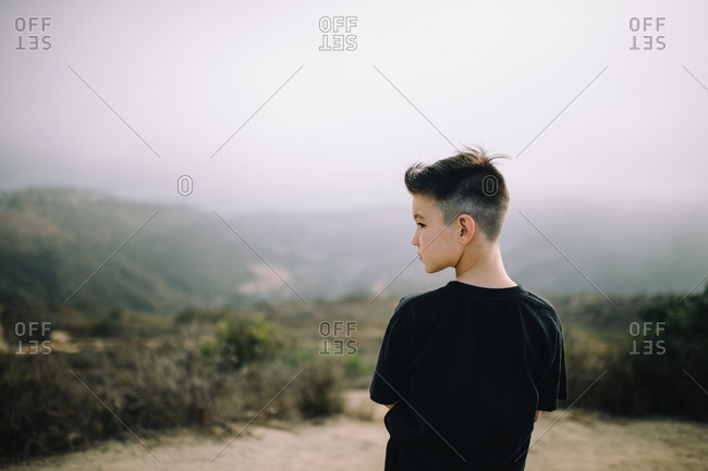 Back view of a young boy with a fade haircut