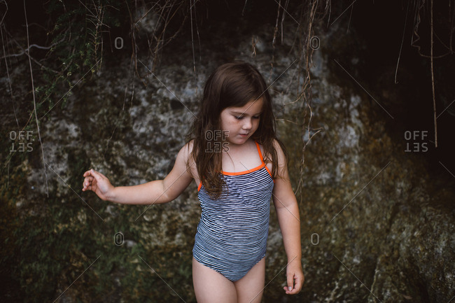 Portrait of young girl in striped bathing suit