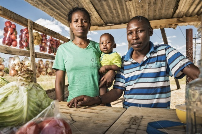 North West,  South Africa - February 5, 2015: African family standing in a roadside shop