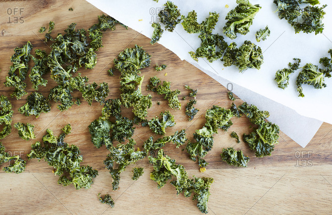 Kale chips on a wooden table