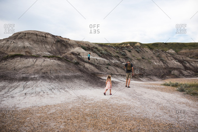 Family walking along a barren hillside