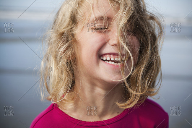 A laughing six year old gir. A portrait.