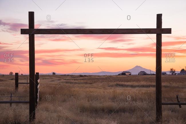 Mountain farmland framed by gate