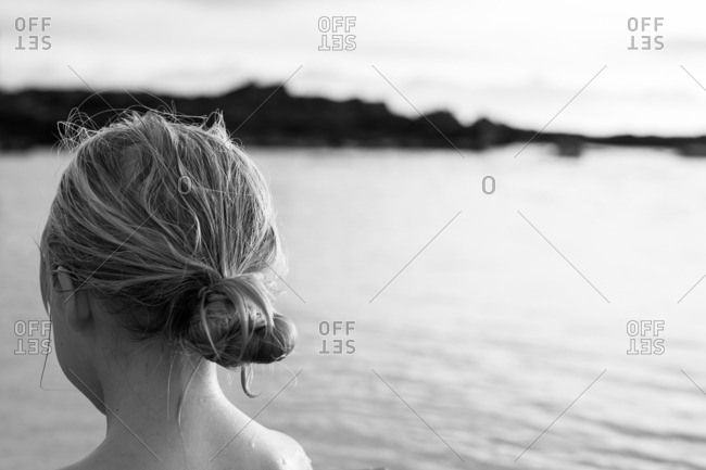 Back of girl's head by shore