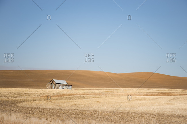 Lone barn amid rolling hills, Washington