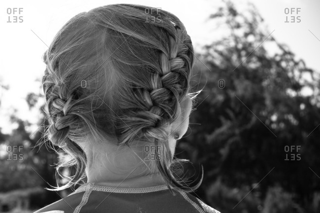Girl's pigtail braids from behind