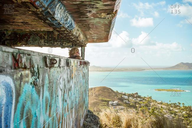 Child in Hawaiian coastal overlook