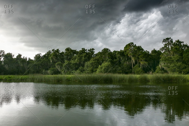Stormy skies over a pond
