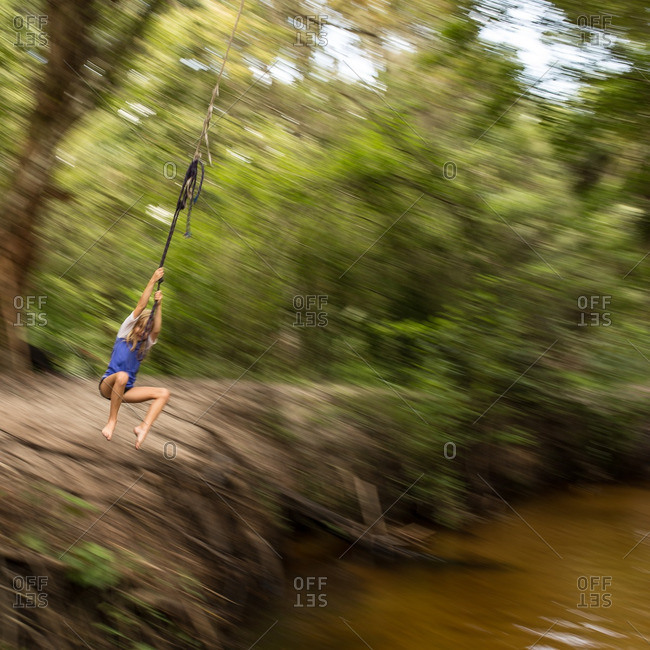 Blurry image of child on rope swing