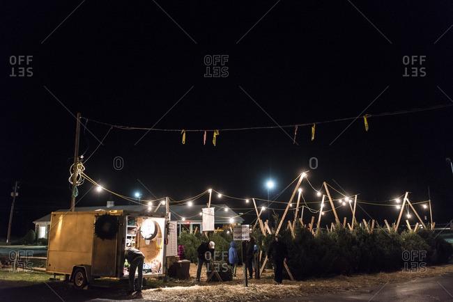 December 4, 2015: Lights hanging above an outdoor Christmas tree market