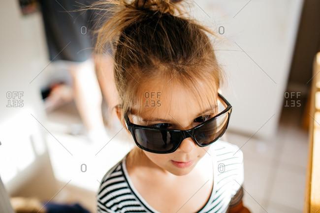 Girl wearing adult sunglasses