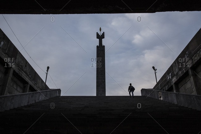 Man on stairs of Cascade monument, Armenia