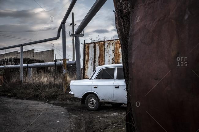 Gyumri, Armenia - March 4, 2016: Soviet era car by gas pipes
