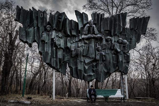 Gyumri, Armenia - March 4, 2016: Boy by Soviet era sculpture