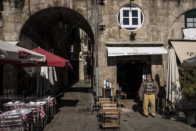 Porto, Portugal - January 16, 2016: A man outside a store