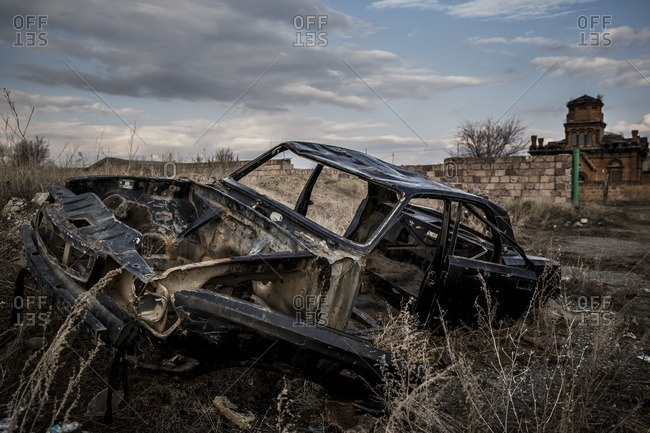 Gyumri, Armenia - March 4, 2016: Abandoned car chassis in field