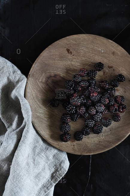 Blackberries on wood cutting board
