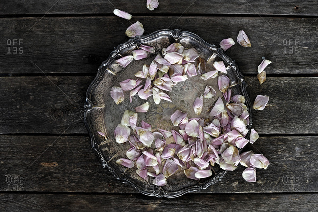 Dried rose petals on silver tray